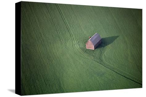 Aerial View of a Barn in the Middle of a Lush Green Field-Paul Chesley-Stretched Canvas Print