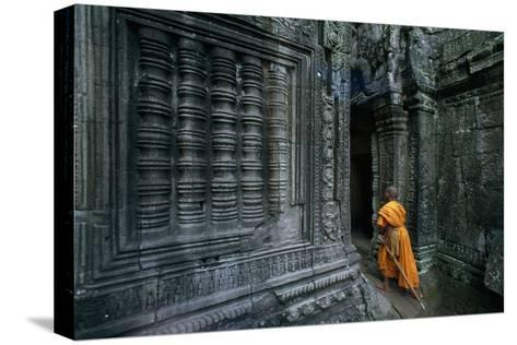 A Monk Explores the Ancient Ruins of the Angkor Wat Temple Complex-Paul Chesley-Stretched Canvas Print