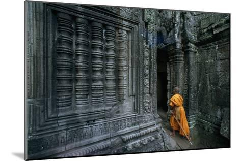 A Monk Explores the Ancient Ruins of the Angkor Wat Temple Complex-Paul Chesley-Mounted Photographic Print