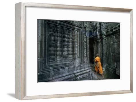 A Monk Explores the Ancient Ruins of the Angkor Wat Temple Complex-Paul Chesley-Framed Art Print