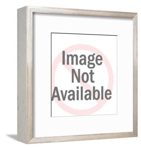 Man Holding Up Oversize Folded Shirt-Pop Ink - CSA Images-Framed Art Print
