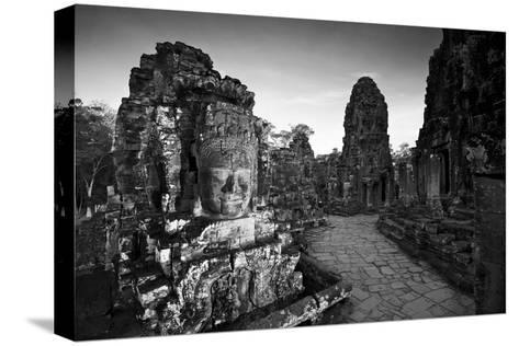 Ornate Stone Carvings at the Buddhist Pyramid Temple, Bayon-Jim Ricardson-Stretched Canvas Print