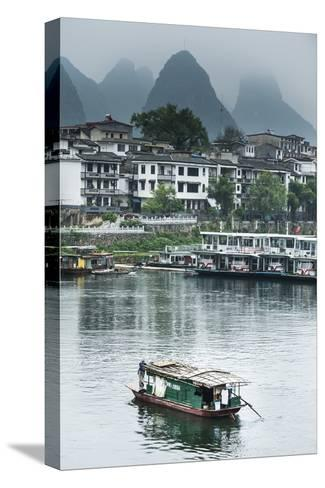 A Boat Crosses the Lijiang River on a Foggy Day in Yangshuo, China-Jonathan Kingston-Stretched Canvas Print