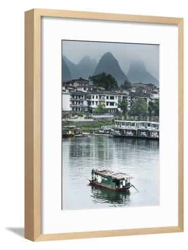 A Boat Crosses the Lijiang River on a Foggy Day in Yangshuo, China-Jonathan Kingston-Framed Art Print