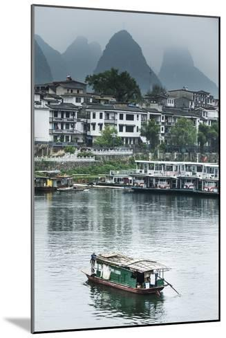 A Boat Crosses the Lijiang River on a Foggy Day in Yangshuo, China-Jonathan Kingston-Mounted Photographic Print