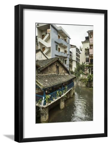 A Restaurant and Apartments Rise Above a River in Yangshuo, China-Jonathan Kingston-Framed Art Print