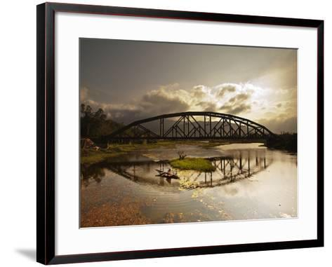 Sunset Over a Bridge in Da Nang with a Small Fisherman's Boat-Alex Saberi-Framed Art Print