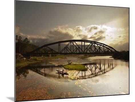 Sunset Over a Bridge in Da Nang with a Small Fisherman's Boat-Alex Saberi-Mounted Photographic Print