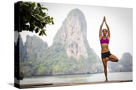 A Woman Doing Tree Pose Or Vrksasana-Cory Richards-Stretched Canvas Print