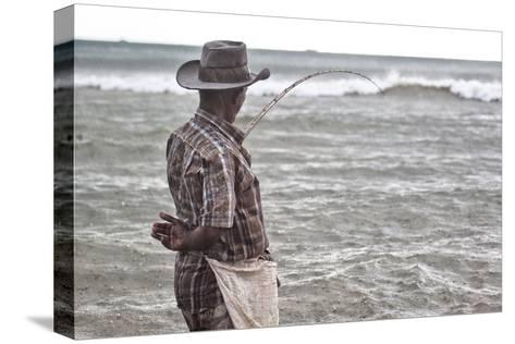 A Man with a Fishing Line on Mirissa Beach-Alex Saberi-Stretched Canvas Print