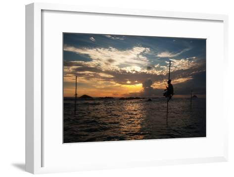 A Stilt Fisherman at Sunset-Alex Saberi-Framed Art Print