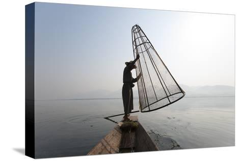 A Basket Fisherman on Inle Lake Prepares to Plunge a Cone Shaped Net-Alex Treadway-Stretched Canvas Print