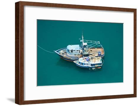 Fishing Boats Are Moored Side by Side in the Green Pacific Waters-Kike Calvo-Framed Art Print