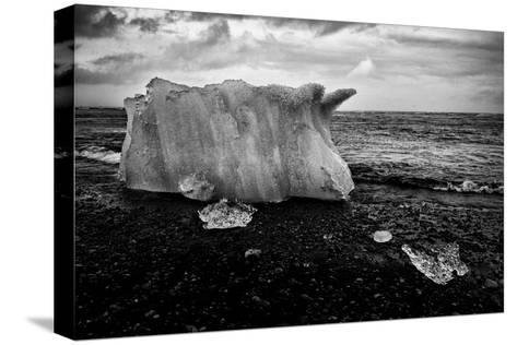 A Small Iceberg on a Volcanic Rock Beach at Jokulsarlon Lake, a Glacial Lagoon-Jonathan Irish-Stretched Canvas Print