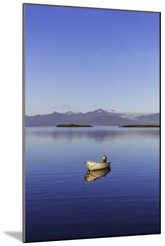 A Johnboat with An Outboard Motor and Its Reflection in Calm Blue Water-Jonathan Irish-Mounted Photographic Print