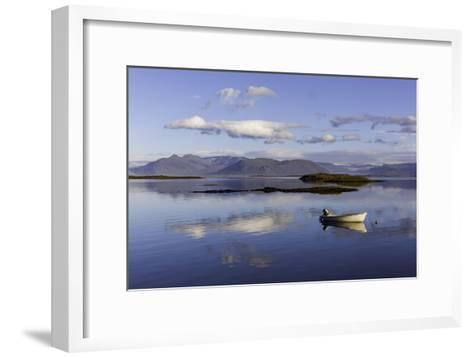 A Johnboat with An Outboard Motor and Its Reflection in Calm Blue Water-Jonathan Irish-Framed Art Print