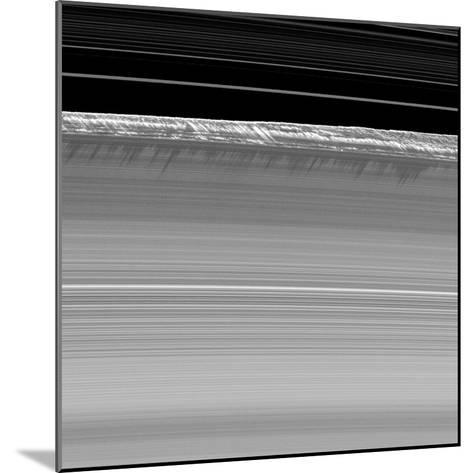 Towering Walls of Ice Rubble Cast Long Shadows on the Outer Edge of Saturn's B Ring--Mounted Photographic Print