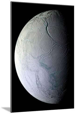Enceladus's Icy Face Reveals Ridges and Folds From the Moon's Active Geology--Mounted Photographic Print