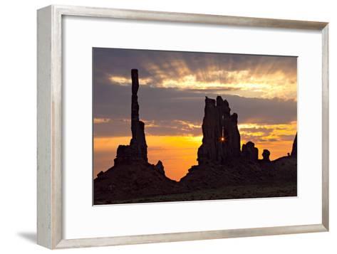 Silhouetted Totem Pole and Yei Bi Chei Rock Formations at Sunrise-Derek Von Briesen-Framed Art Print