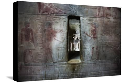 A Statue Through a Window in a Bas Relief Covered Wall in the Tomb of Ti-Alex Saberi-Stretched Canvas Print