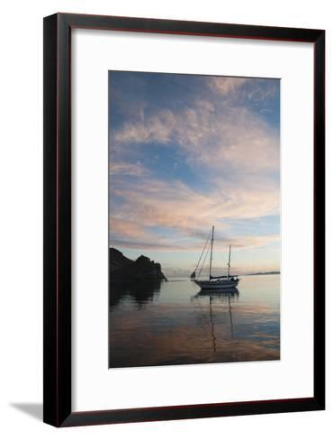 A Sailboat Anchored in a Bay During a Colorful Sunset-James Forte-Framed Art Print