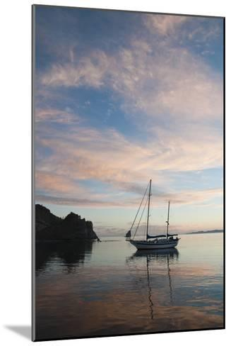 A Sailboat Anchored in a Bay During a Colorful Sunset-James Forte-Mounted Photographic Print