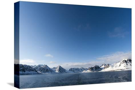 A Scenic View of Ice Covered Mountains Surrounding Magdalenefjorden-Sergio Pitamitz-Stretched Canvas Print