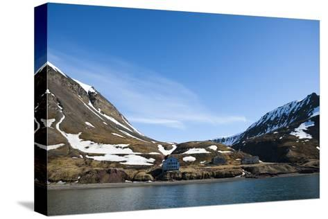 An Old Settlement Nestled Among Cliffs Near Longyearbyen on the Bay of Adventfjorden-Sergio Pitamitz-Stretched Canvas Print