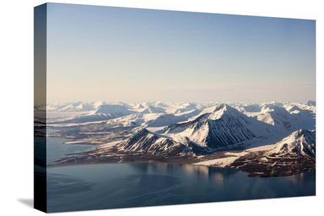 Sunlight Highlights Ice Covered Mountains on Spitsbergen Island-Sergio Pitamitz-Stretched Canvas Print