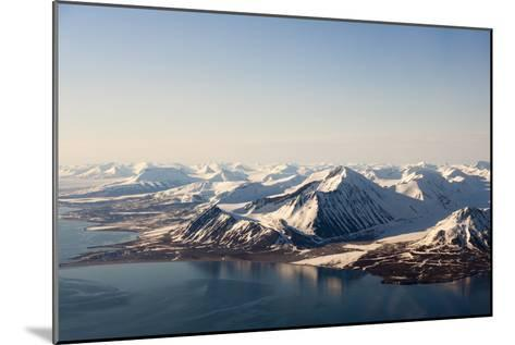 Sunlight Highlights Ice Covered Mountains on Spitsbergen Island-Sergio Pitamitz-Mounted Photographic Print