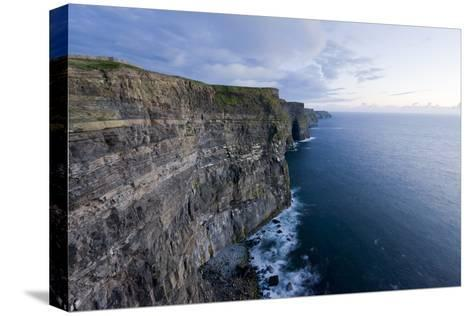 Heavy Clouds Over the Cliffs of Moher and the Atlantic Ocean-Jeff Mauritzen-Stretched Canvas Print