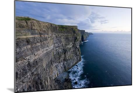 Heavy Clouds Over the Cliffs of Moher and the Atlantic Ocean-Jeff Mauritzen-Mounted Photographic Print