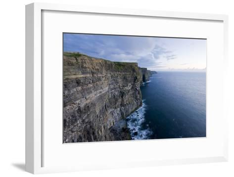 Heavy Clouds Over the Cliffs of Moher and the Atlantic Ocean-Jeff Mauritzen-Framed Art Print
