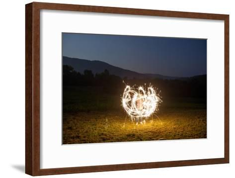 A Child Plays with Sparklers in a  Field in Lost Cove, Tennessee-Stephen Alvarez-Framed Art Print