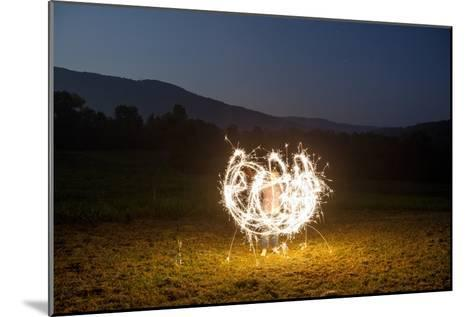 A Child Plays with Sparklers in a  Field in Lost Cove, Tennessee-Stephen Alvarez-Mounted Photographic Print