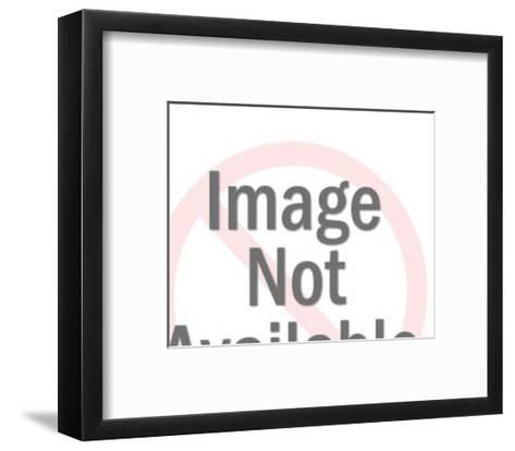 Man Leaning Over to Read Book-Pop Ink - CSA Images-Framed Art Print
