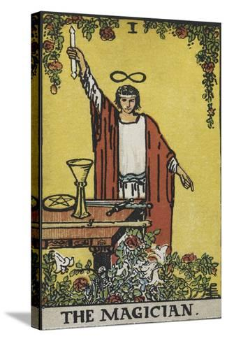 Tarot Card With a Magician Holding an Object Wearing a Red Robe, Before a Table With a Sword-Arthur Edward Waite-Stretched Canvas Print