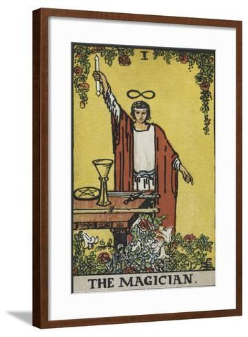 Tarot Card With a Magician Holding an Object Wearing a Red Robe, Before a Table With a Sword-Arthur Edward Waite-Framed Art Print
