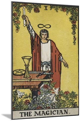 Tarot Card With a Magician Holding an Object Wearing a Red Robe, Before a Table With a Sword-Arthur Edward Waite-Mounted Giclee Print
