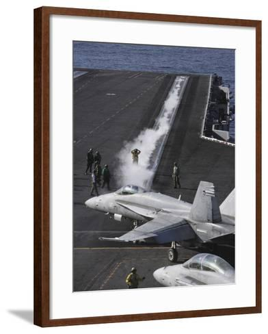 An FA-18D Hornet Taxis To the Catapult Aboard the Aircraft Carrier USS Ronald Reagan-Stocktrek Images-Framed Art Print
