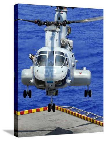 A CH-46E Sea Knight Helicopter Prepares To Land On the Flight Deck of USS Peleliu-Stocktrek Images-Stretched Canvas Print