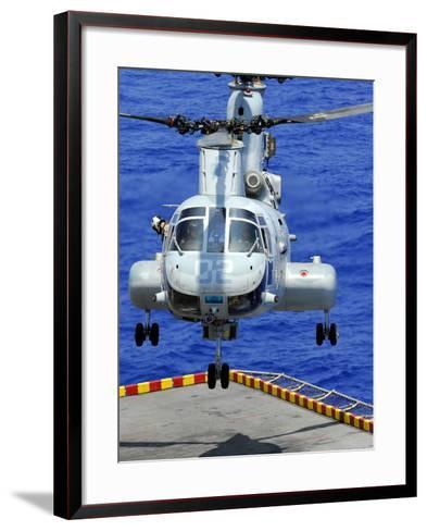 A CH-46E Sea Knight Helicopter Prepares To Land On the Flight Deck of USS Peleliu-Stocktrek Images-Framed Art Print