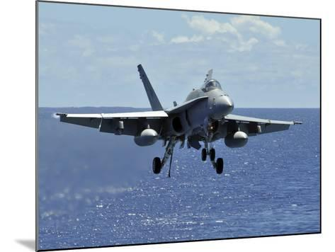 An F/A-18C Hornet Approaches the Flight Deck of the Aircraft Carrier USS Ronald Reagan-Stocktrek Images-Mounted Photographic Print