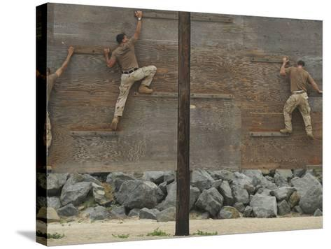Sailors Crawl Across Narrow Planks of Wood As Part of An Obstacle Course-Stocktrek Images-Stretched Canvas Print