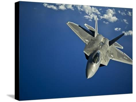 An F-22 Raptor in Flight Near the Hawaiian Islands-Stocktrek Images-Stretched Canvas Print