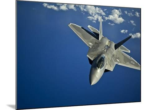 An F-22 Raptor in Flight Near the Hawaiian Islands-Stocktrek Images-Mounted Photographic Print