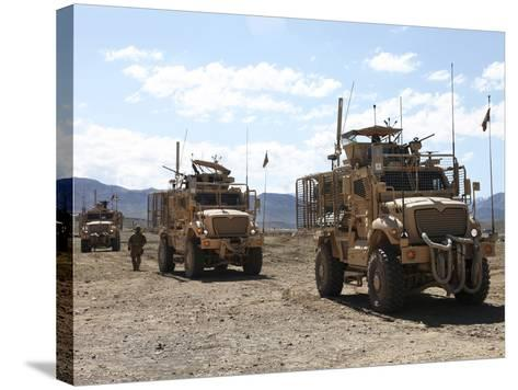 Three U.S. Army Mine Resistant Ambush Protected Vehicles-Stocktrek Images-Stretched Canvas Print