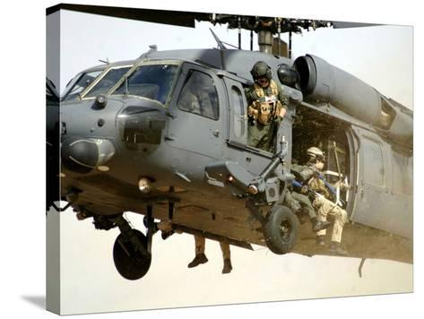 Pararescuemen Aboard a Helicopter Prepare For Landing-Stocktrek Images-Stretched Canvas Print