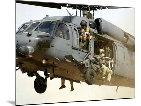 Pararescuemen Aboard a Helicopter Prepare For Landing-Stocktrek Images-Mounted Photographic Print