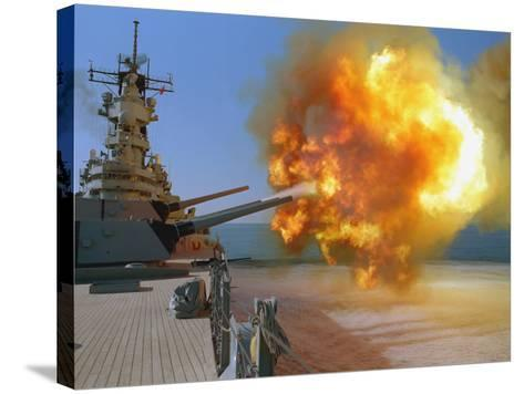 Battleship USS Wisconsin Fires a Round from One of the Mark 7 16-inch/50-caliber Guns-Stocktrek Images-Stretched Canvas Print